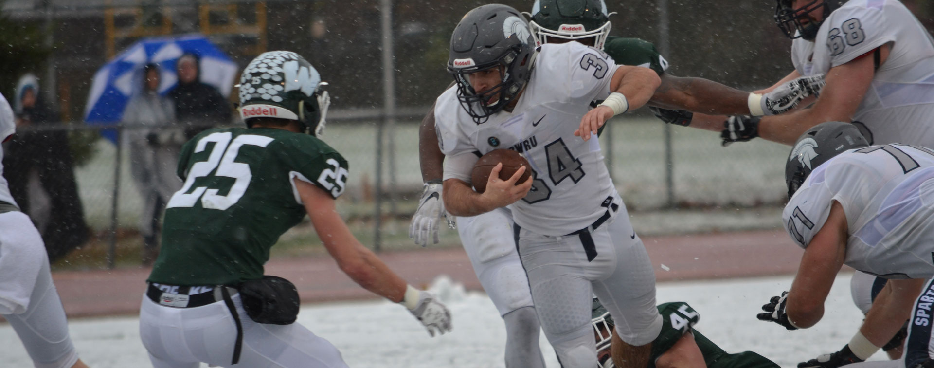 Photo of CWRU senior Aaron Aguilar breaking through a tackle