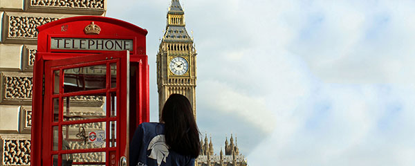 Image of CWRU student in a telephone box near Big Ben