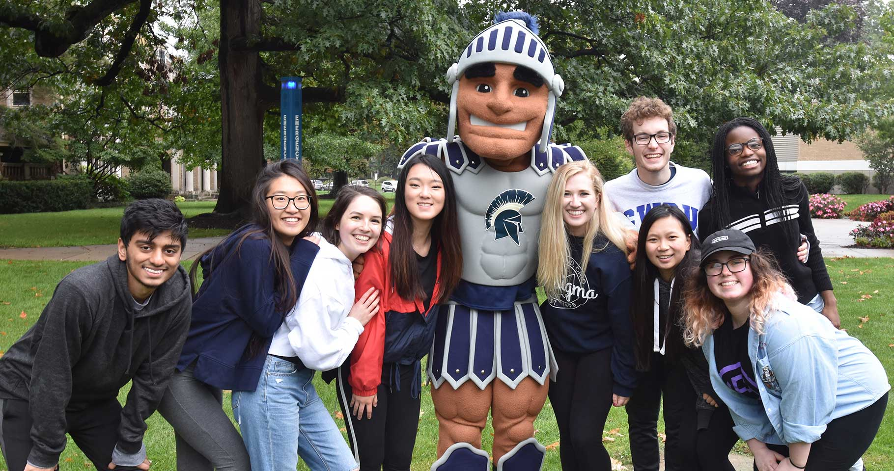 CWRU students with mascot at homecoming