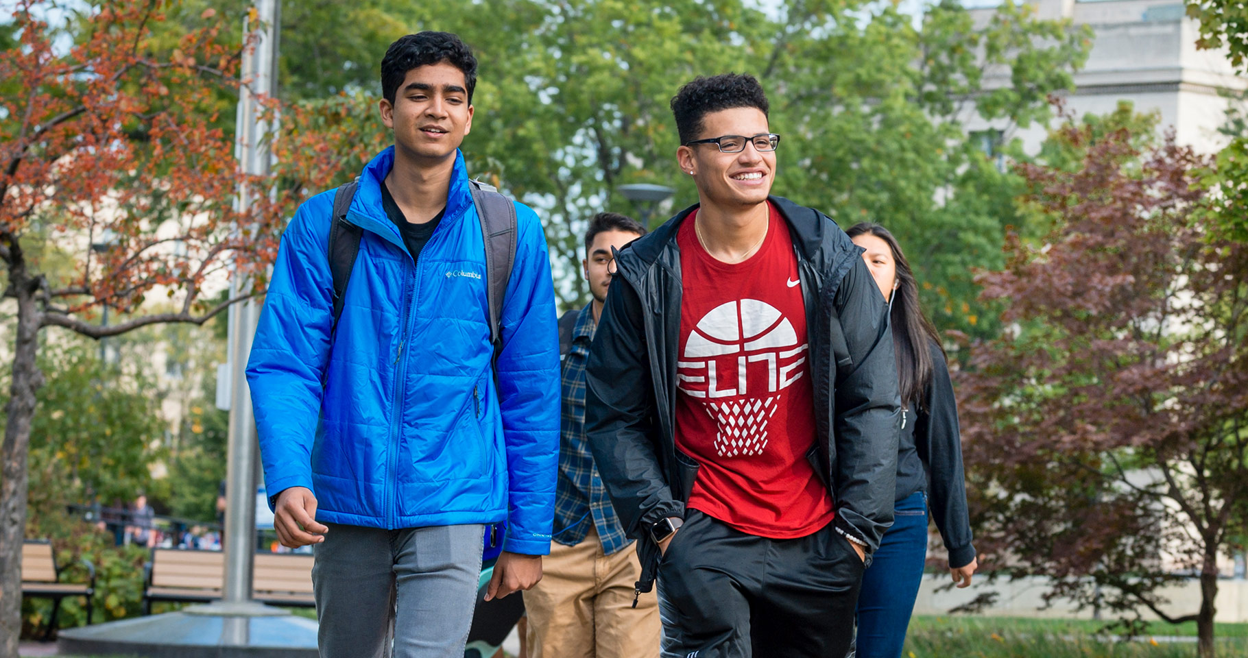 CWRU students smiling while walking outside