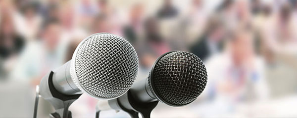 Two microphones on a podium