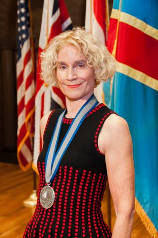 Martha C. Nussbaum with medal