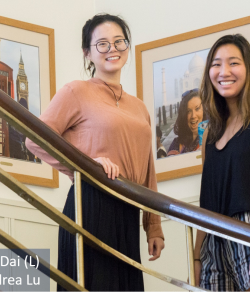 A picture of Andrea Lu and Weiwei Dai standing on the stairs inside Tomlinson Hall