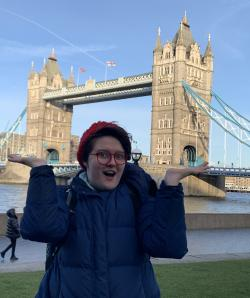 Talia Eshenbaugh poses in front of the Tower Bridge in London, England