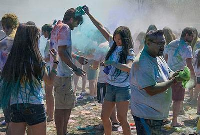 Students dumping colored powder on each other