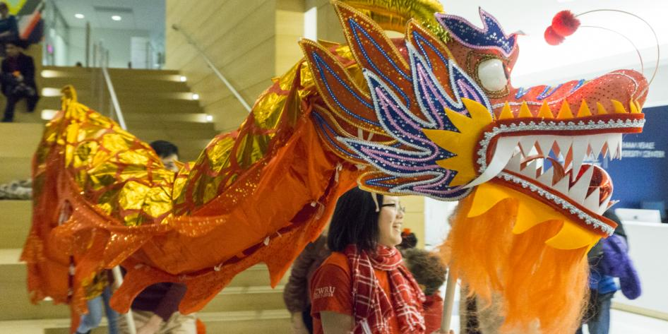 Students celebrate Lunar New Year with a dragon