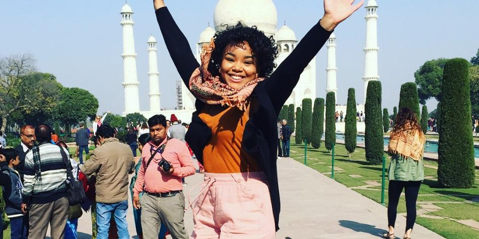 Study abroad student jumping in front of Taj Mahal