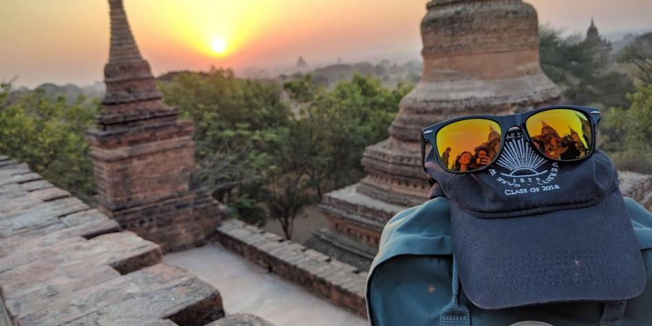 Study abroad student backpack and sunglasses overlooking Myanmar temples