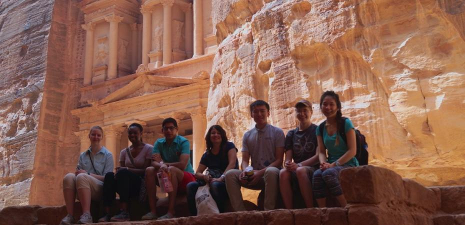 A group of students sit with a faculty member during a short-term study abroad program in Jordan