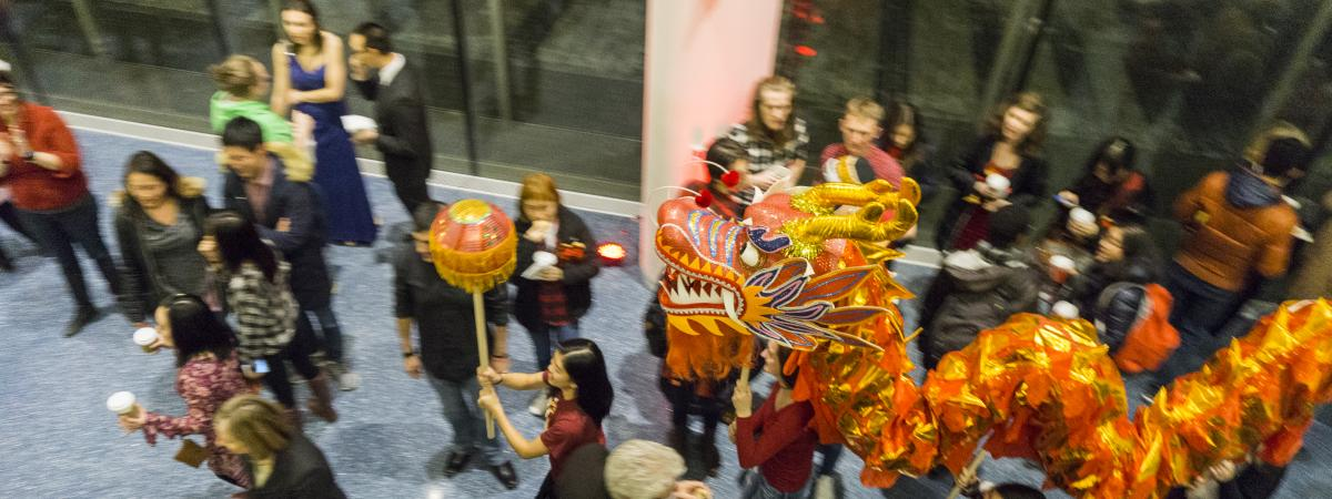 A picture of CWRU students guiding the dragon through the 2017 Lunar New Year celebration