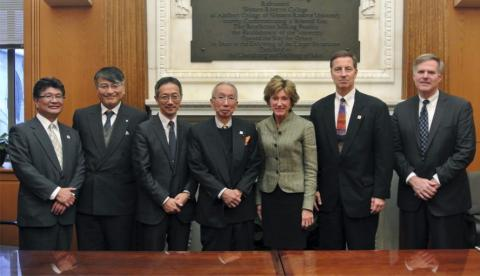 President Snyder and David Fleshler pose with visitors from Tohoku University