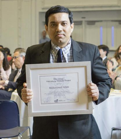 Mohammad Islam with his award