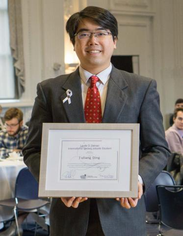 "A picture of Yuliang ""Bill"" Ding with his award"