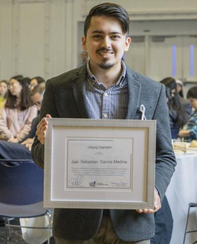 A picture of J. Sebastian Garcia Medina with his award