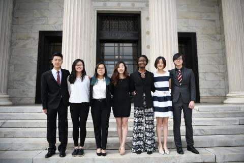 The officers of International Club stand outside on the steps of the Cleveland Art Museum