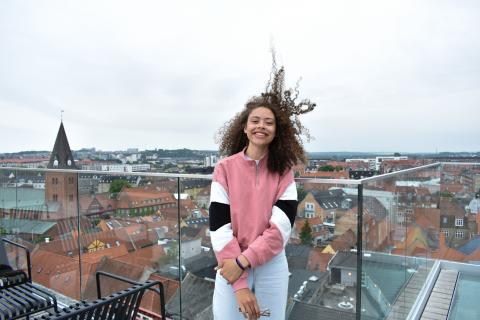 Katie Brown stands outside overlooking a city during her study abroad