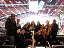 A picture of students at a Cleveland Cavalier's game with their backs to the court