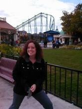 A picture of Autumn Beechler Stebing at Cedar Point standing outside in front of a roller coaster