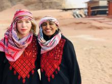 A picture of Nandita Kannapadi standing in the desert in Jordan with her friend during their study abroad