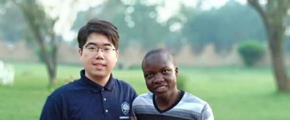 Bill Ding with a student from Makerere University in Uganda