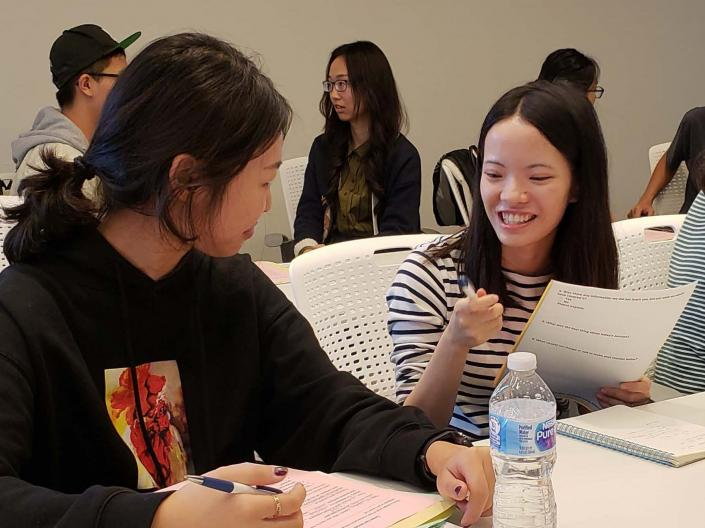 Two international students talking during an International Student Success Series event