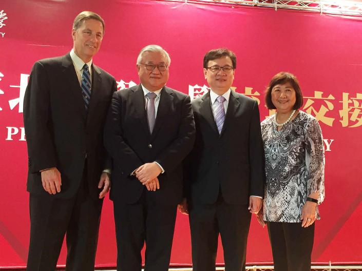 Vice Provost David Flesher stands with leaders of Taipei Medical University in Taiwan