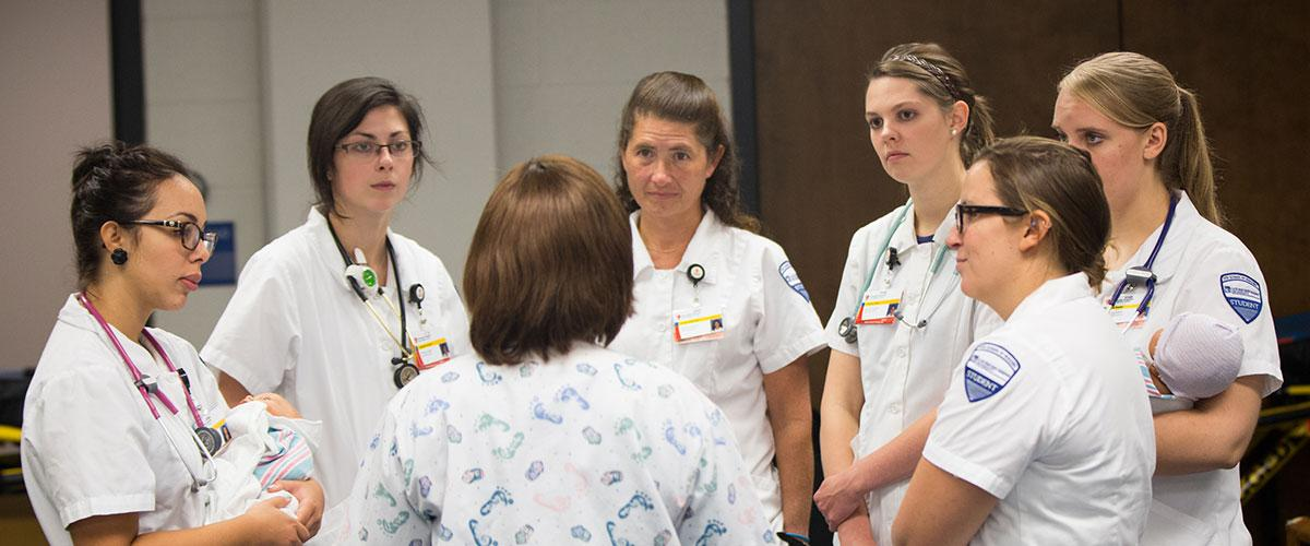 Nursing students talking in a group