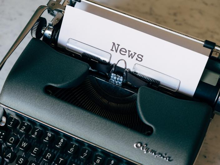 Typewriter with document that the heading NEWS