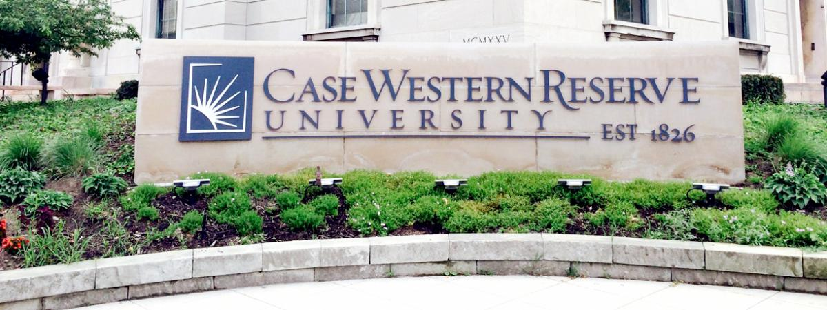Case Western Reserve University Logo outdoors on a stone plaque.