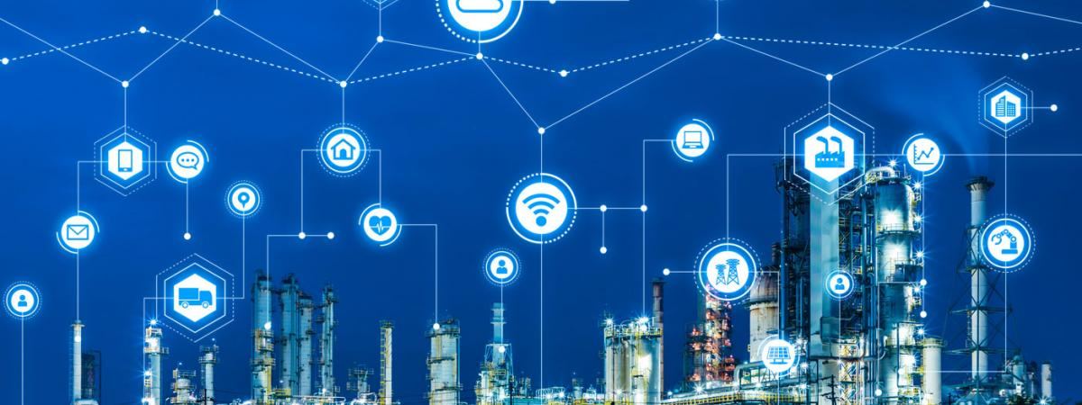 Industrial complex with IoT icons above it
