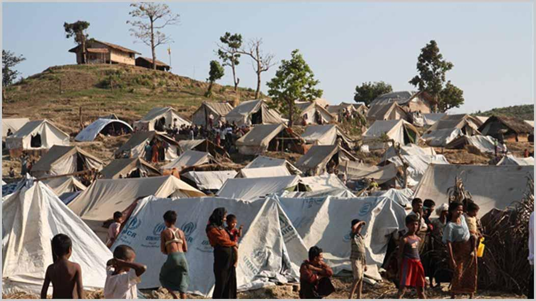 View of Rohingya muslims refugee camp with white tents and many people