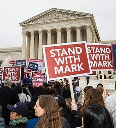 "Image of protestors outside capital building with signs that say ""Stand With Mark"""