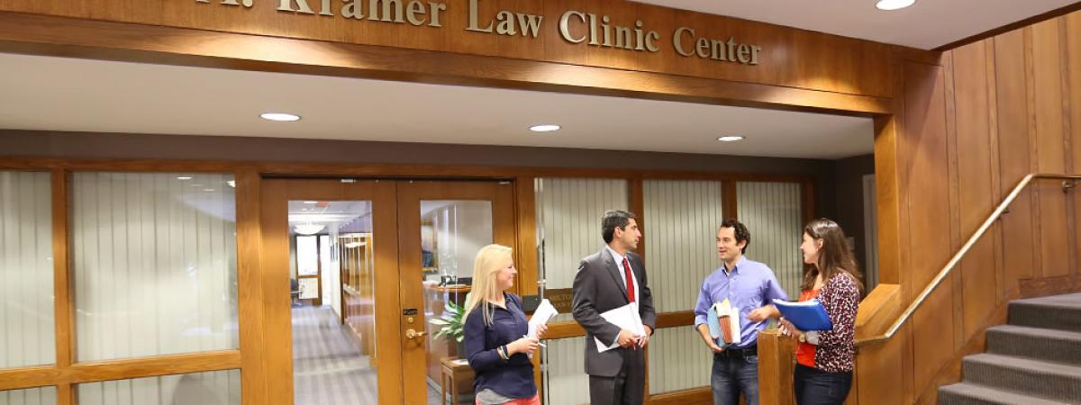 faculty and staff consulting out the Milton A. Kramer Law Clinic Center