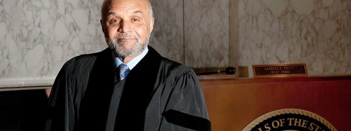 image of judge in robe in front of his bench