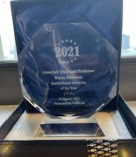 Photo of the Institutional Advocate award presented to Professor Adamson