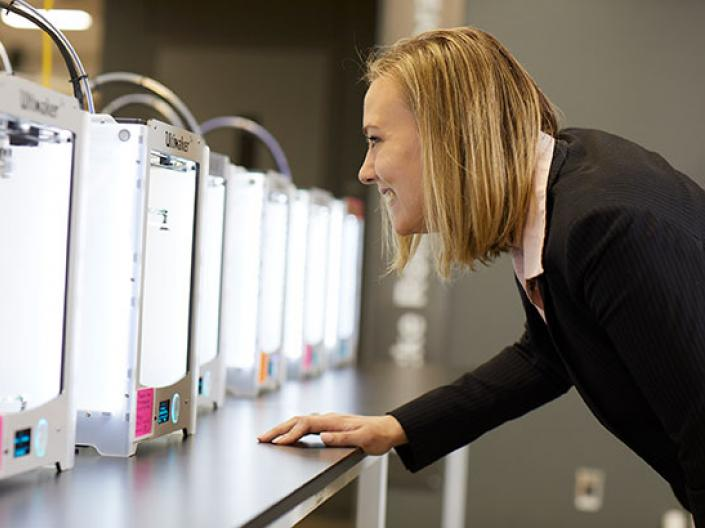 CWRU Law student looking 3-D printers