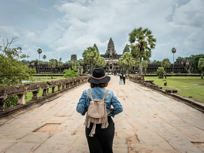 A CWRU law student walking in Cambodia