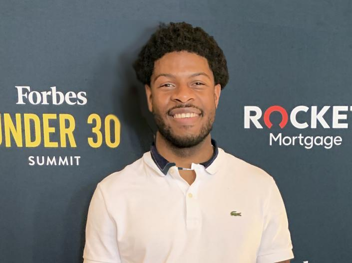 Photo of Justin Hill at the Forbes Under 30 event
