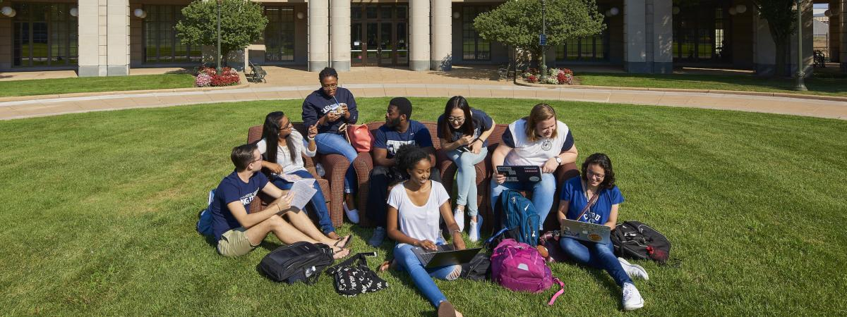 Students Sitting on the Oval in front of Kelvin Smith Library
