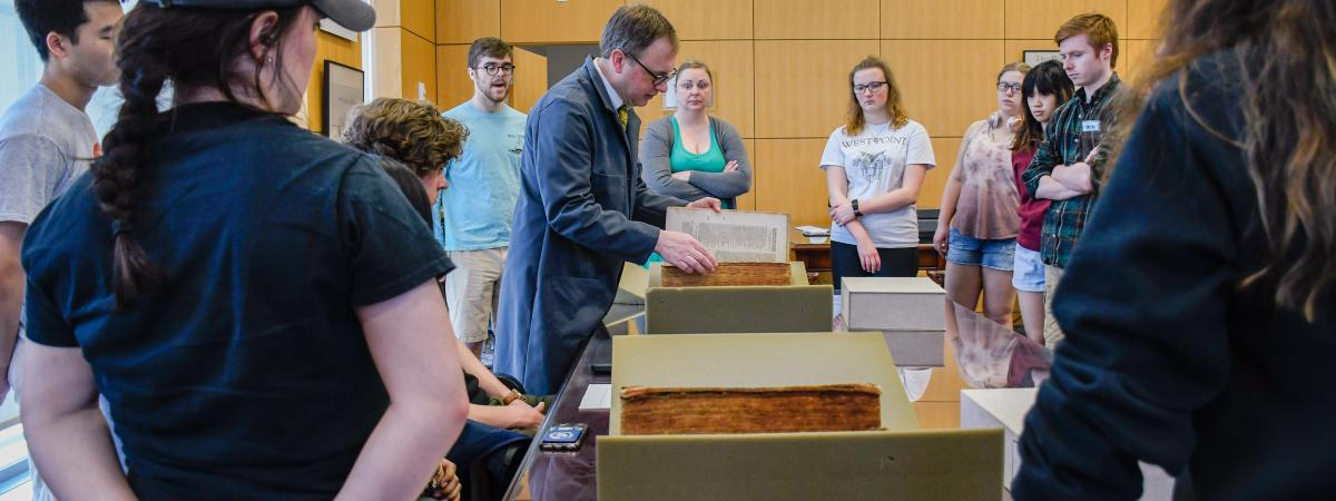 Head of Special Collections, Bill Claspy, instructing a group of students in the Hatch Reading Room