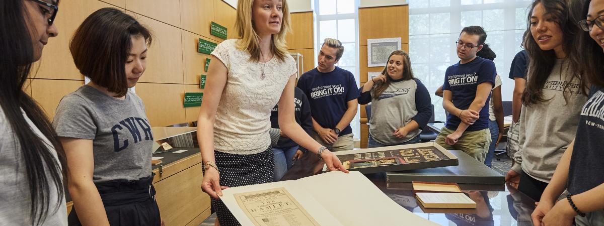 Students and Staff Looking at Documents in the Special Collections Hatch Reading Room.