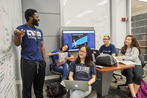CWRU Students studying in a collaboration room.
