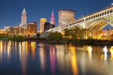 Skyline of Cleveland at night with the lake in front