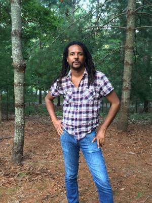 colson whitehead posing in forest