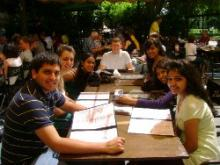 Group of students sitting at a table outside for lunch.