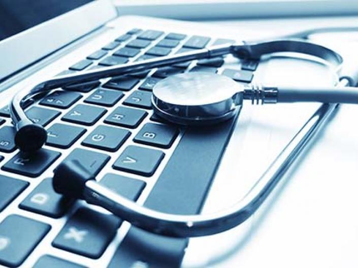 Picture of a stethoscope on top of a computer keyboard