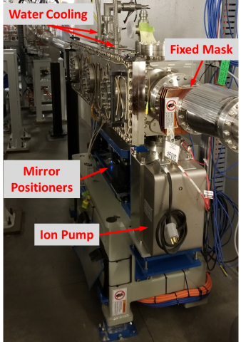 The XFP mirror chamber is mounted on a large grey stand, with motorized positioners, water cooling lines, and an ion pump visible.