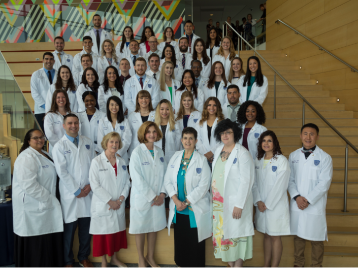 Physician Assistant members posing on the steps for a photo