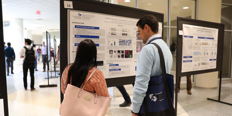 Two Researchers Review Poster