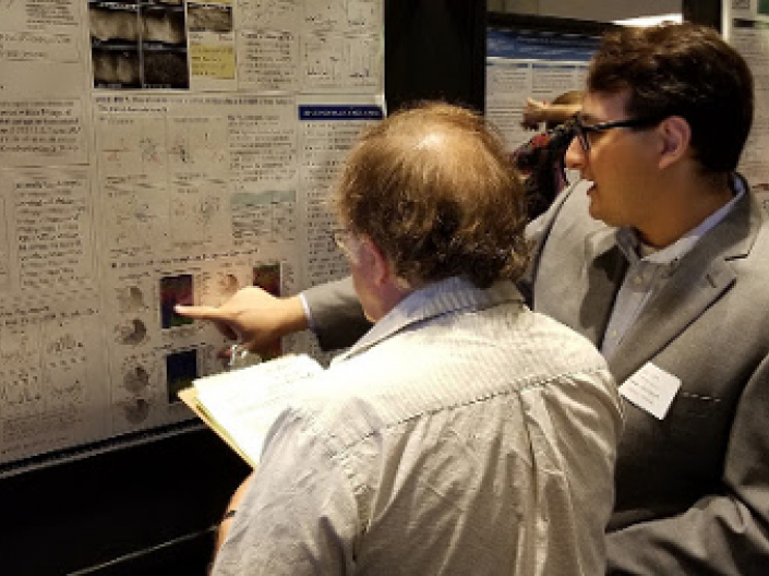 Two researchers look at research posters
